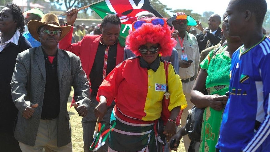 Kenyan people dance in Afraha Stadium, Nakuru, Kenya, as they attend a thanks giving rally, Saturday, April 16, 2016. Kenyan President Uhuru Kenyatta and five others who had been charged with crimes against humanity at the International Criminal Court held a rally attended by thousands to celebrate the withdrawal of the charges against them. The rally has been opposed by opposition leader Raila Odinga and some members of civic organizations who say it does not respect the suffering of the victims of violence following a disputed presidential election late 2007. (AP Photo/Kevin Midigo)