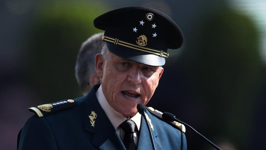 Mexico's Defense Secretary Gen. Salvador Cienfuegos Zepeda speaks to soldiers at the Number 1 military camp in Mexico City, Saturday, April 16, 2016. Cienfuegos formally apologized to the country for a video-recorded incident of torture involving two soldiers and a federal police officer. (AP Photo/Marco Ugarte)
