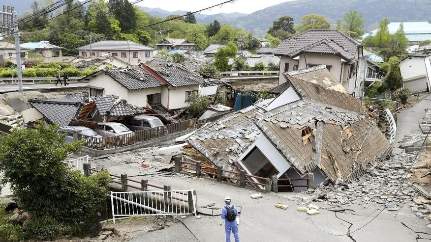 Resident houses are seen destroyed after an earthquake in Mashiki, Kumamoto prefecture, southern Japan, Saturday, April 16, 2016. Powerful earthquakes a day apart shook southern Japan, trapping many beneath flattened homes and sending thousands to seek shelter in gymnasiums and hotel lobbies. (Yusuke Ogata/Kyodo News via AP) JAPAN OUT, MANDATORY CREDIT