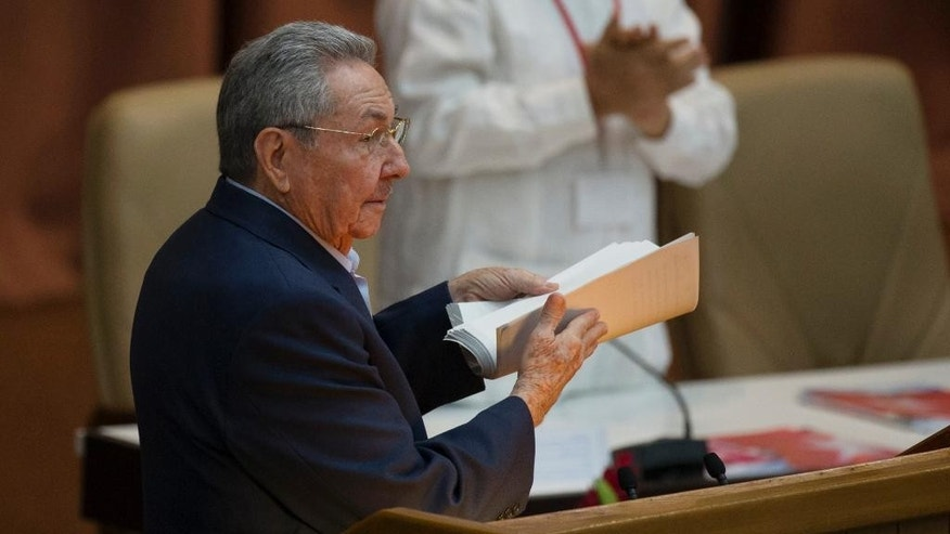 Cuba's President Raul Castro carries away a copy of his speech after addressing the 7th Cuban Communist Party Congress in Havana, Cuba, Saturday, April 16, 2016. Castro delivered a grim report on the state of the country, saying that the communist bureaucracy had failed to implement most of the hundreds of changes the ruling party launched five years ago to stimulate the stagnant centrally controlled economy. The party holds its four-day long Congress every five years. (Ismael Francisco/Cubadebate via AP)