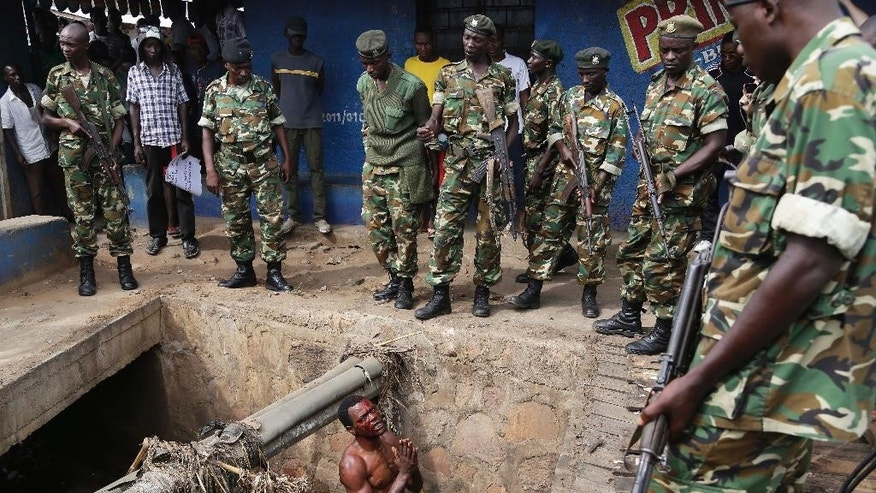 "FILE - In this Thursday, May 7, 2015 file photo, Jean Claude Niyonzima, a suspected member of the ruling party's Imbonerakure youth militia, pleads with soldiers to protect him from a mob of demonstrators after he came out of a sewer  in the Cibitoke district of Bujumbura, Burundi. Former U.N. Secretary General Kofi Annan said Sunday, April 17, 2016 that the situation in Burundi is ""very delicate"" and blamed President Pierre Nkurunziza for the crisis and not cooperating with the international community to resolve the conflict. (AP Photo/Jerome Delay, File)"