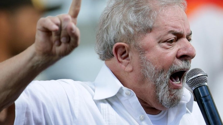 Brazil's former President Luiz Inacio Lula da Silva speaks during a meeting of Social Movements for Democracy, at a camp set up by supporters of his protege, President Dilma Rousseff, in Brasilia, Brazil, Saturday, April 16, 2016. The lower chamber of Brazil's Congress on Friday began a debate on whether to impeach Rousseff, a question that underscores deep polarization in Latin America's largest country and most powerful economy. The crucial vote is slated for Sunday. (AP Photo/Eraldo Peres)