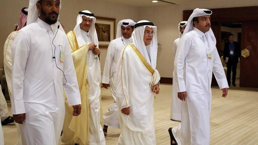 Saudi Oil Minister Ali al-Naimi, center right, arrives at an oil-producers' meeting in Doha, Qatar, on Sunday, April 17, 2016. Oil-producing countries are meeting in Qatar to discuss a possible freeze of production to counter low global prices, but Iran's last-minute decision to stay home could dilute the impact of any agreement. (AP Photo/Jon Gambrell)