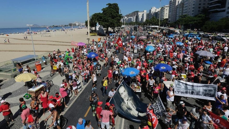 People gather to protest against the impeachment of Brazil's President Dilma Rousseff, in Rio de Janeiro, Brazil, Sunday, April 17, 2016. Emotions have been running high since the impeachment proceedings began in the Chamber of Deputies on Friday, with lawmakers holding raucous, name-calling session. Outside the legislature, waves of pro-and anti-impeachment demonstrators are expected to flood the capital, Brasilia. (AP Photo/Silvia Izquierdo)