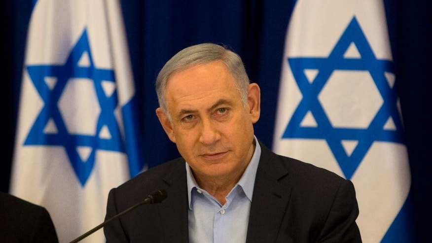 Israeli Prime Minister Benjamin Netanyahu chairs the weekly cabinet meeting in the Israeli controlled Golan Heights, Sunday, April 17, 2016. Israeli Prime Minister Benjamin Netanyahu said Sunday his country will never withdraw from the war won Golan Heights and the strategic plateau bordering Syria will forever stay in Israeli hands. (AP Photo/Sebastian Scheiner, Pool)