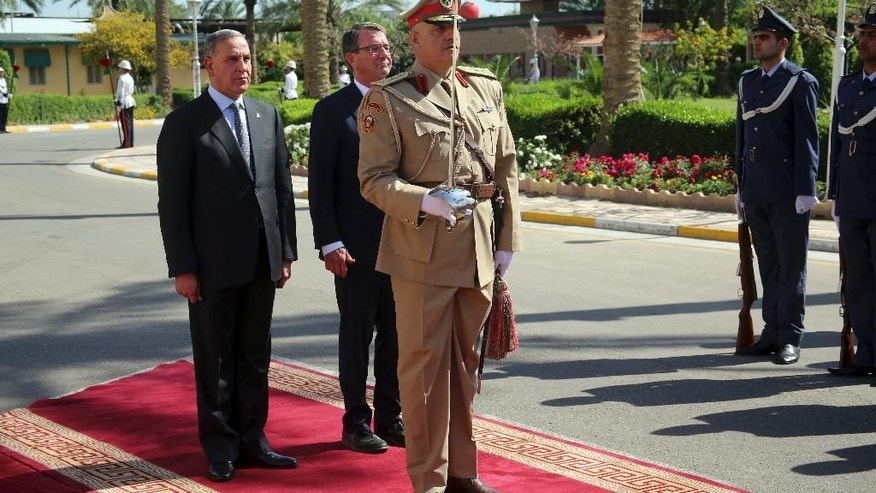 Visiting U.S. Defense Secretary Ash Carter, left, and his Iraqi counterpart Khaled al-Obeidi review an honor guard during a welcome ceremony at the Ministry of Defense, Baghdad, Iraq, Monday, April 18, 2016. (AP Photo)