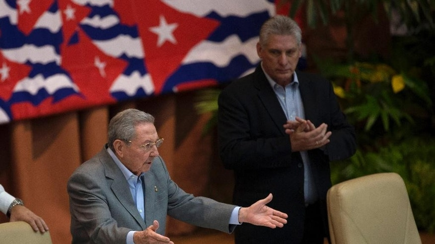 Cuba's President Raul Castro acknowledges applause at the end of a session of the 7th Congress of the Cuban Communist Party in Havana, Cuba, Monday, April 18, 2016. Cuba's Vice President Miguel Diaz Canel is pictured at right. (Ismael Francisco/Cubadebate via AP)