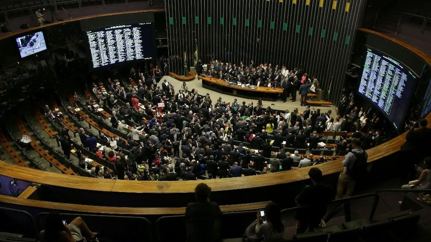 The Chamber of Deputies meets to vote on whether or not to impeachment Brazil's President Dilma Rousseff in Brasilia, Brazil, Sunday, April 17, 2016. The vote will determine whether the impeachment proceeds to the Senate. Rousseff is accused of violating Brazil's fiscal laws to shore up public support amid a flagging economy. (AP Photo/Eraldo Peres)