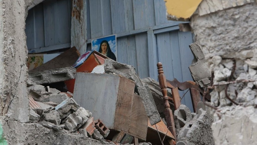 A destroyed house is seen in Pedernales, Ecuador, Sunday, April 17, 2016. A magnitude-7.8 quake, the strongest since 1979, hit Ecuador flattening buildings, buckling highways along its Pacific coast and killing hundreds. (AP Photo/Dolores Ochoa)