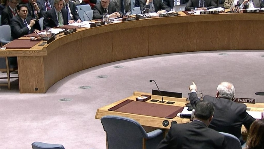 In this image made from a video provided by UNTV, Israel's Ambassador Danny Danon, top left, and Palestinian envoy Riyad Mansour, bottom second from right, speak to one another at an United Nations Security Council meeting Monday, April 18, 2016, at United Nations headquarters. (UNTV via AP) MANDATORY CREDIT