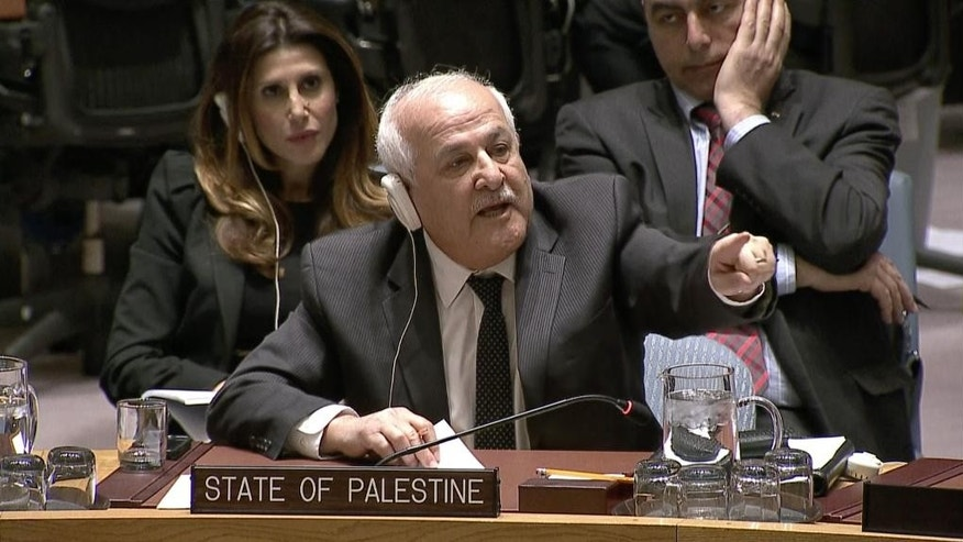 In this image made from a video provided by UNTV, Palestinian envoy Riyad Mansour, center, speaks to Israel's Ambassador Danny Danon, not pictured, at an United Nations Security Council meeting Monday, April 18, 2016, at United Nations headquarters. (UNTV via AP) MANDATORY CREDIT