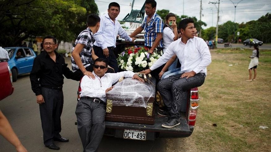 "Family members accompany a coffin containing the remains of a loved one who died in the 7.8-magnitude earthquake, to a nearby cemetery in Portoviejo, Ecuador, Monday, April 18, 2016. The Saturday night quake left a trail of ruin along Ecuador's normally placid Pacific Ocean coast. At least 350 people died and thousands are homeless. President Rafael Correa said early Monday that the death toll would ""surely rise, and in a considerable way."" (AP Photo/Rodrigo Abd)"