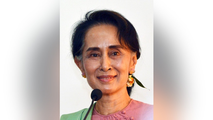 FILE - In this April 5, 2016 file photo, leader of National League for Democracy party (NLD) and Myanmar's new Foreign Minister Aung San Suu Kyi smiles during a press conference after meeting Chinese Foreign Minister Wang Yi in Naypyitaw, Myanmar. Suu Kyi vowed Monday, April 18, 2016 to push for constitutional amendments to build a true democracy in the Southeast Asian country as it emerges from decades of military control. (AP Photo/Aung Shine Oo, File)