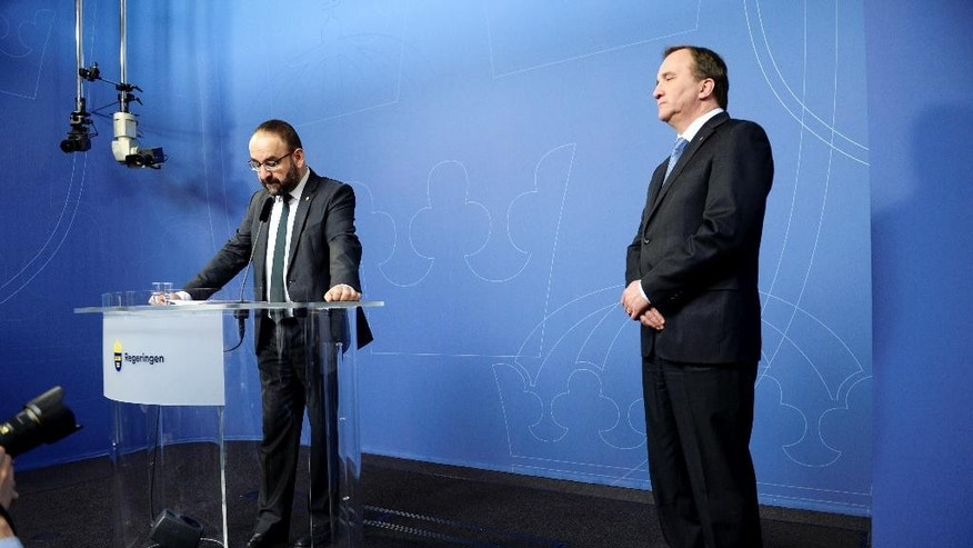 Sweden's Housing Minister Mehmet Kaplan appears before the media to confirm his resignation with Prime Minister Stefan Loven, right, in Stockholm, Sweden, April 18, 2016, following comments where Kaplan likened Israel's treatment of Palestinians to what happened to Jews in Nazi Germany.  Green Party member, Kaplan stepped down Monday amid mounting questions over his contacts with Islamists and ultra-nationalists from his native Turkey. (Jessica Gow / TT via AP) SWEDEN OUT