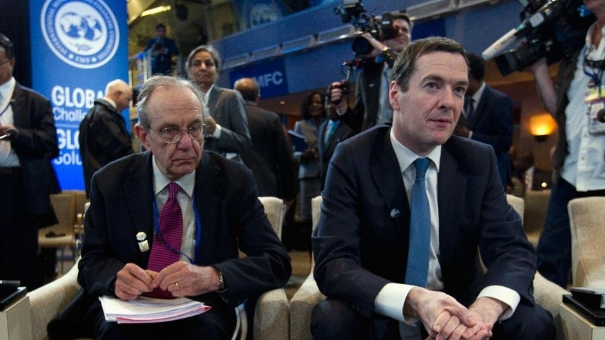 Italian Finance Minister Pier Carlo Padoan, left, sits with Britain's Chancellor of the Exchequer George Osborne during the International Monetary and Financial Committee (IMFC) conference at the World Bank/IMF Spring Meetings at IMF headquarters in Washington, Saturday, April 16, 2016. ( AP Photo/Jose Luis Magana)