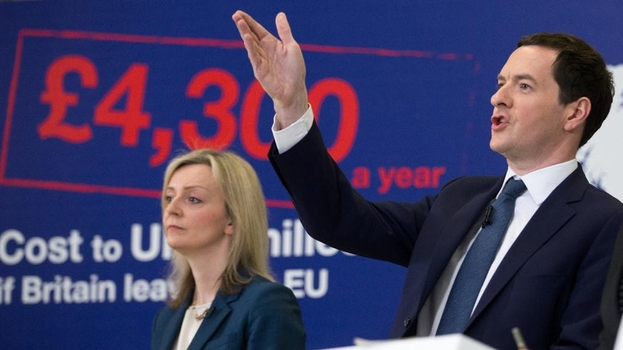 Chancellor of the Exchequer George Osborne, right, during his speech next to Environment Secretary Liz Truss at the National Composites Centre at the Bristol and Bath Science Park in Bristol, England, Monday, April 18, 2016. Osborne has put a price tag on leaving the European Union, costing Britain the equivalent of $6,100 per household. The estimate is based on a 200-page analysis of the long-term costs and benefits of EU membership and its alternatives that George Osborne published Monday April 18, 2016 ahead of the June 23 referendum. (Matt Cardy/PA via AP)    UNITED KINGDOM OUT      -     NO SALES       -      NO ARCHIVES