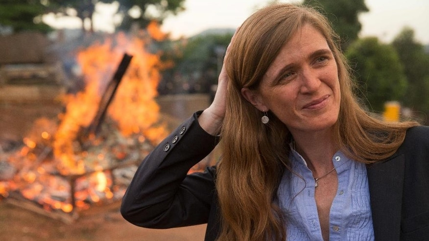 U.S. Ambassador to the United Nations Samantha Power stands near the first Cameroon Ivory Burn at the Palais des Congres in Yaounde, Cameroon, Tuesday, April 19, 2016, which was lit to highlight the need to halt the Ivory trade in order to save Africa's elephants. Power is visiting Cameroon, Chad, and Nigeria to highlight the growing threat Boko Haram poses to the Lake Chad Basin region. (AP Photo/Andrew Harnik)