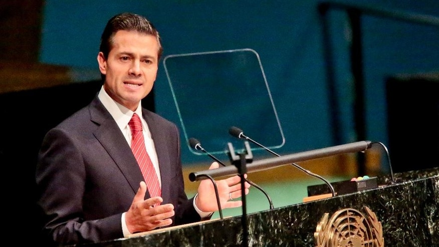 Enrique Pena Nieto, President of the United Mexican States, addresses the U.N. special session on global drug policy, Tuesday April 19, 2016 at UN. headquarters.  It is the first U.N. special session to address global drug policy in nearly 20 years.  (AP Photo/Bebeto Matthews)