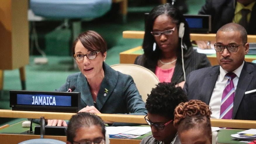 Jamaica's new Foreign Affairs Minister Kamina Johnson Smith, left, speaks as she address the U.N. special session on global drug policy, Tuesday April 19, 2016 at UN. headquarters.  (AP Photo/Bebeto Matthews)