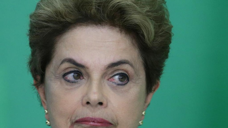 Brazil's President Dilma Rousseff reacts during a press conference where she spoke about her impeachment process, at Planalto Presidential Palace, in Brasilia, Monday, April 18, 2016. President Rousseff appeared on the verge of losing office after a congressional vote to impeach her and signs suggested only tenuous support for her in the Senate, which will decide whether to remove her amid a political and economic crisis. (AP Photo/Eraldo Peres)