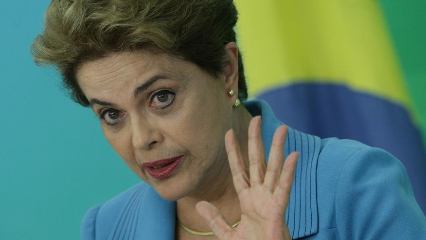 Brazil's President Dilma Rousseff speaks during a press conference about her impeachment process, at Planalto Presidential Palace, in Brasilia, Monday, April 18, 2016. President Rousseff appeared on the verge of losing office after a congressional vote to impeach her and signs suggested only tenuous support for her in the Senate, which will decide whether to remove her amid a political and economic crisis. (AP Photo/Eraldo Peres)