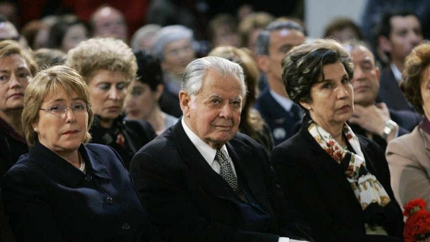 FILE - In this Sept. 11, 2006 file photo, Chile's former President Patricio Aylwin, center, attends a ceremony marking the 33rd anniversary of the military coup led by Gen. Augusto Pinochet, at La Moneda presidential palace in Santiago, Chile, sitting between Chile's President Michelle Bachelet, left, and Congresswoman Isabel Allende, daughter of Salvador Allende, the president who was toppled in the coup. Aylwin, who lead Chile's transition from military dictatorship to democracy, died on Tuesday, April 19, 2016, according to the Interior Minister Jorge Burgos. He was 97. (AP Photo/Santiago Llanquin, File)