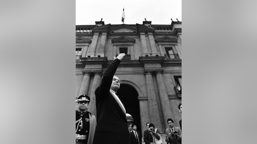 In this March 11, 1990 photo, Chile's newly sworn-in President Patricio Aylwin acknowledges the crowd outside La Moneda presidential palace in Santiago, Chile. Aylwin, who lead Chile's transition from military dictatorship to democracy, died on Tuesday, April 19, 2016, according to the Interior Minister Jorge Burgos. He was 97. (AP Photo/Marco Ugarte)