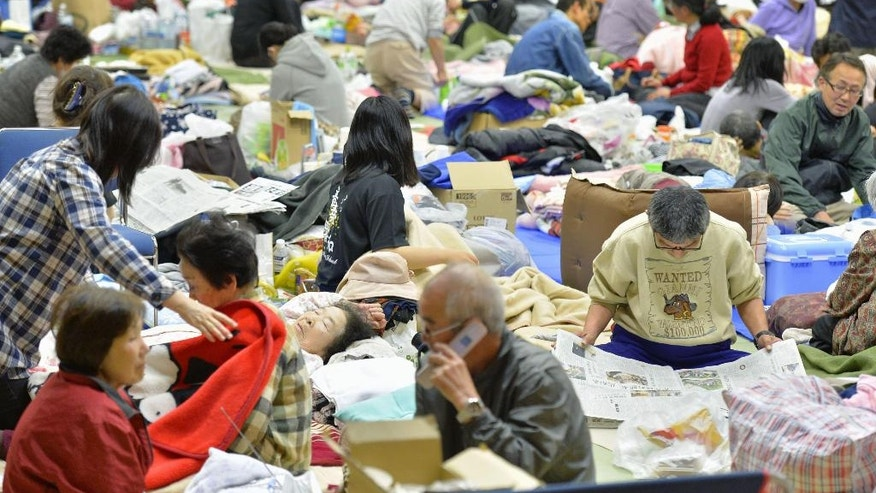 April 18, 2016: People rest at a shelter in Mashiki, Kumamoto prefecture, Japan.
