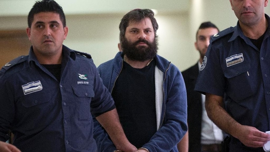 Israeli Yosef Haim Ben David, convicted in the killing of 16-year-old Palestinian Mohammed Abu Khdeir, arrives to a court in Jerusalem Tuesday.