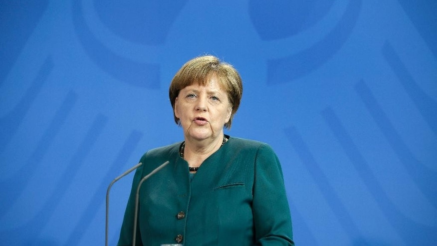 German Chancellor Angela Merkel addresses the media during a joint news conference as part of a meeting with Palestinian President Mahmoud Abbas at the chancellery in Berlin, Germany, Tuesday, April 19, 2016. (AP Photo/Michael Sohn)