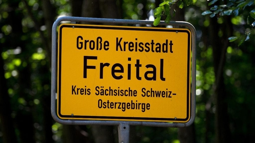 "FILE - The July 22, 2015 file photo shows the city sign of Freital in eastern Germany. German prosecutors said Tuesday, April 19, 2016 they've arrested five people on suspicion of founding a right-wing terror group to attack refugee homes and other facilities. The federal prosecutors' office said the five German nationals were arrested on Tuesday and several apartments in the eastern state of Saxony searched. They say they formed the ""Freital Group,"" named after a Dresden suburb that has seen a string of anti-refugee protests and other incidents, by July last year.  (Arno Burgi/dpa, file via AP)"