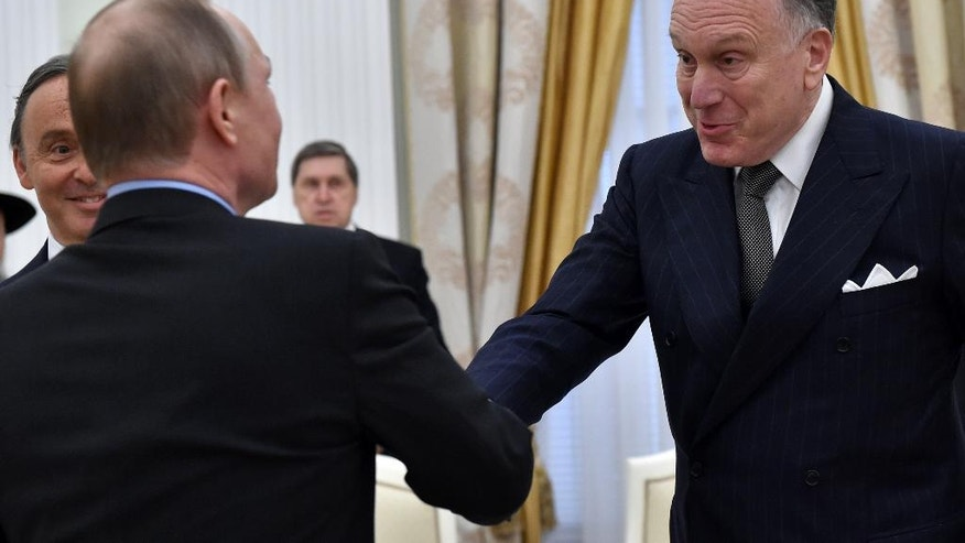 Russian President Vladimir Putin, left, shakes hands with President of World Jewish Congress Ronald S. Lauder during a meeting at the Kremlin in Moscow, Russia, on Tuesday, April 19, 2016. (Krill Kudryavtsev/Pool photo via AP)