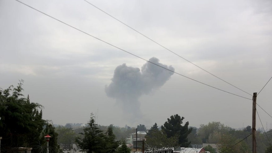 Smoke rises after a suicide attack in Kabul, Afghanistan, Tuesday, April 19, 2016. Sediq Sediqqi, spokesman for the Afghan Interior Ministry, says the suicide attack was followed by gunfire, and the area has been surrounded by security forces. (AP Photo/Rahmat Gul)