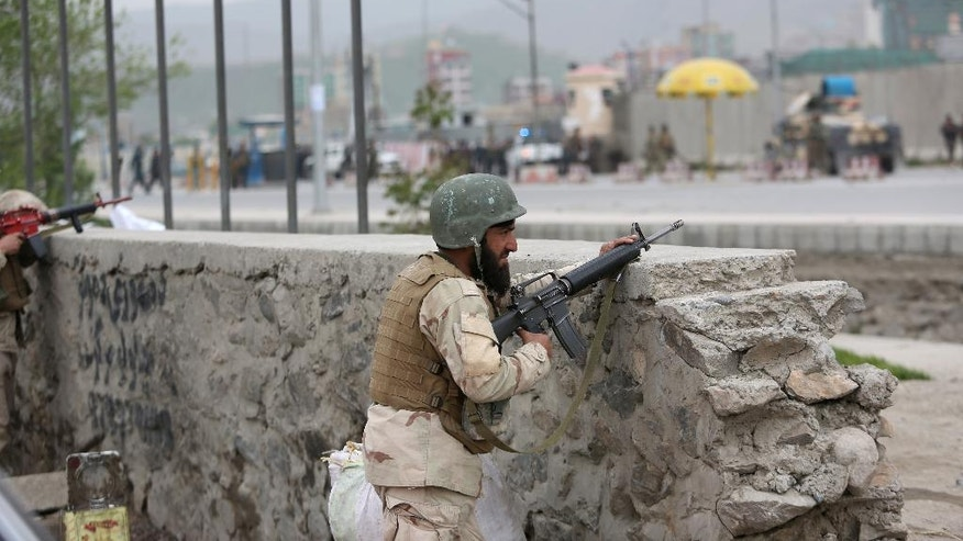 Afghan soldiers responds to a Taliban-claimed suicide attack in Kabul, Afghanistan, Tuesday, April 19, 2016. Taliban insurgents have stepped up their attacks against the security forces since announcing the start of their spring offensive last week. (AP Photo/Rahmat Gul)