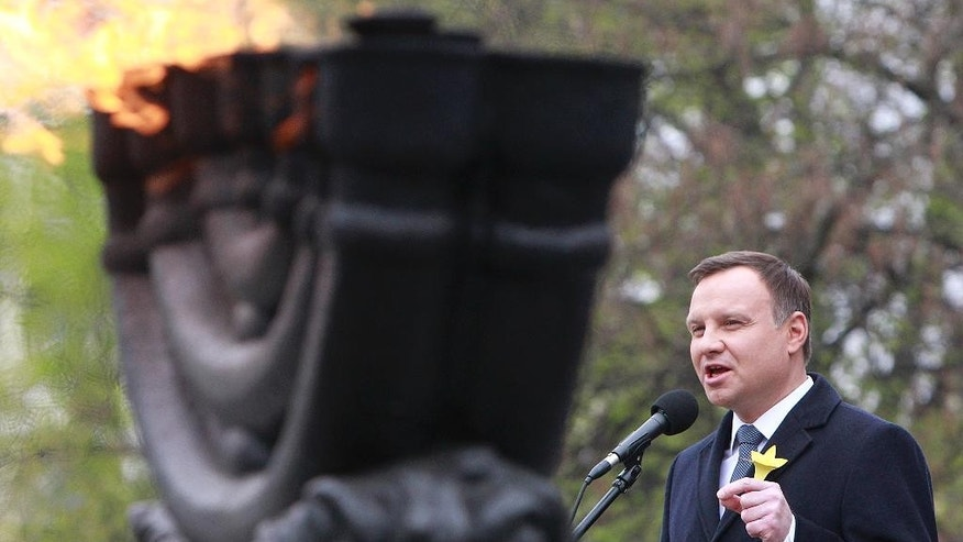 Polish President Andrzej Duda speaks during the official ceremony marking the 73rd anniversary of the Warsaw Ghetto Uprising at the Monument to the Ghetto Heroes in Warsaw, Poland, Tuesday, April 19, 2016. (AP Photo/Czarek Sokolowski)