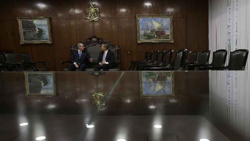 Senate President Renan Calheiros, right, meets with the President of the Chamber of Deputies Eduardo Cunha, at the National Congress in Brasilia, Monday, April 18, 2016. The vote late Sunday in favor of impeachment against President Dilma Rousseff proceeds to the Senate, where a majority vote will determine whether Rousseff is put on trial and suspended while Vice President Michel Temer temporarily takes over. (AP Photo/Eraldo Peres)