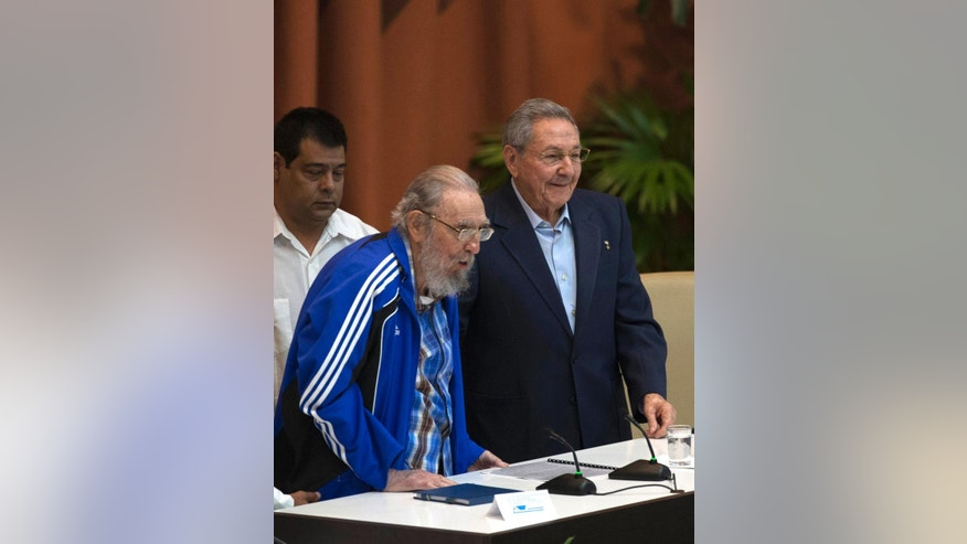 Fidel Castro, left and his brother, Cuba's President Raul Castro, attend the closing ceremonies of the 7th Congress of the Cuban Communist Party, as they national anthem is played in Havana, Cuba, Tuesday, April 19, 2016. Fidel Castro formally stepped down in 2008 after suffering gastrointestinal ailments and public appearances have been increasingly unusual in recent years. (Ismael Francisco/Cubadebate via AP)