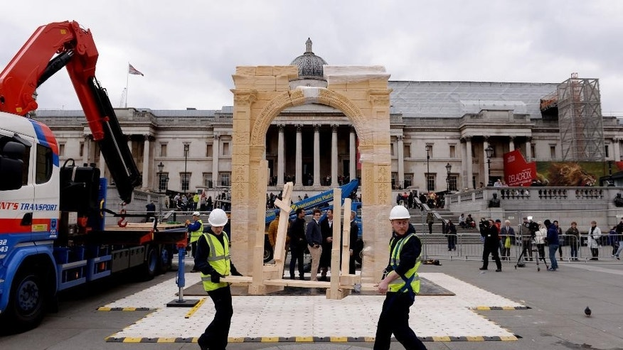 A reconstruction of the 2000 year-old Triumphal Arch from Palmyra Syria  is  erected in Trafalgar Square in London Monday April 18, 2016. The triumphal arch destroyed by the Islamic State group in Syria was been recreated in London's Trafalgar Square. The Arch of Triumph in Palmyra formed part of one of the world's most extensive ancient archaeological sites. The 5.5 meter (18-foot) Egyptian marble replica  about two-thirds the size of the original,  was created by the Institute for Digital Archaeology using 3-D printing technology. (Stefan Rousseau/PA via AP)  UNITED KINGDOM OUT