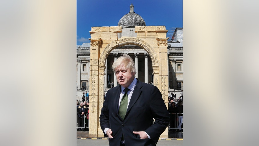 The Mayor of London, Boris Johnson, poses for the media after unveiling an imposing scale replica of Palmyra's Triumphal Arch in Trafalgar Square, in London, Tuesday, April 19, 2016. The triumphal arch destroyed by the Islamic State group in Syria was been recreated in London's Trafalgar Square. The Arch of Triumph in Palmyra formed part of one of the world's most extensive ancient archaeological sites. The 5.5 meter (18-foot) Egyptian marble replica  about two-thirds the size of the original,  was created by the Institute for Digital Archaeology using 3-D printing technology. (AP Photo/Frank Augstein)