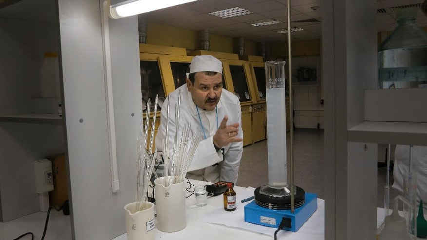 In this photo taken Wednesday, March 23, 2016, a laboratory worker checks the radiation level on samples taken from the 4th unit destroyed by explosion at the Chernobyl nuclear power plant, Chernobyl, Ukraine. Thirty years after the world's worst nuclear accident, the Chernobyl nuclear power plant is surrounded by both a hushed desolation and clangorous activity, the sense of a ruined past and a difficult future. (AP Photo/Efrem Lukatsky)