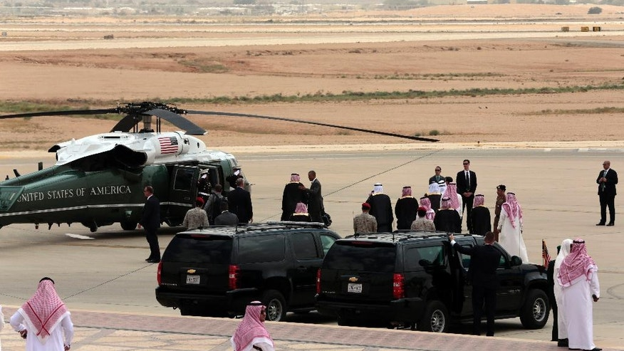 U.S. President Barack Obama greets Saudi officials on his arrival in Riyadh, Saudi Arabia, Wednesday, April 20, 2016. Obama is expected to meet with King Salman and attend a meeting of Gulf Arab heads of state of the six Gulf Cooperation Council countries during his two-day visit to the kingdom. (AP Photo/Hasan Jamali)