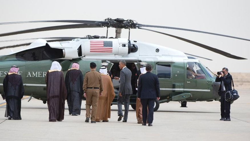 President Barack Obama walks to Marine One after arriving on Air Force One at King Khalid International Airport in Riyadh, Saudi Arabia, Wednesday, April 20, 2016. The President begins a six day trip to strategize with his counterparts in Saudi Arabia, England and Germany on a broad range of issues with efforts to rein in the Islamic State group being the common denominator in all three stops. Walking with the president are Ambassador Joseph W. Westphal, U.S. Ambassador to the Kingdom of Saudi Arabia, Linda Westphal, Prince Faisal bin Bandar bin Abdulaziz Al-Saud, Governor of Riyadh, Engineer Ibrahim Al-Sultan, Mayor of Riyadh Region, Fahad Al-Saheel, Royal Protocol - Airports In-charg. (AP Photo/Carolyn Kaster)