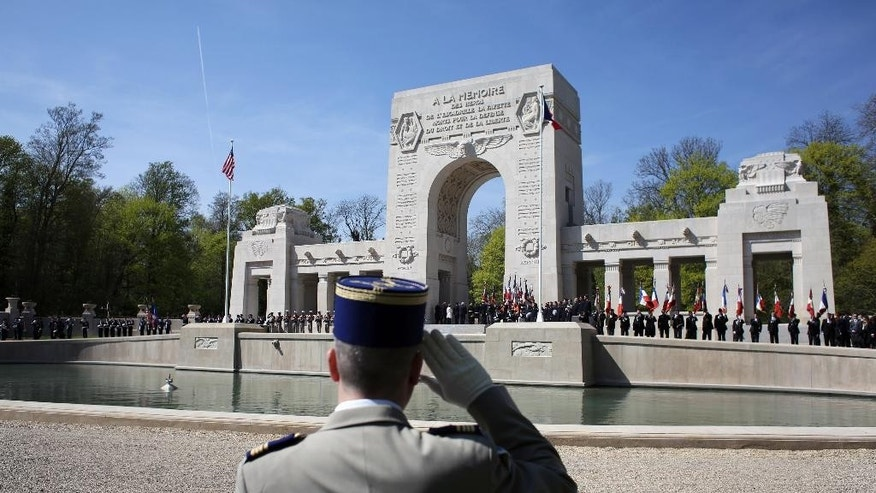 A French soldier salutes during a ceremony honoring the lives of the American pilots who volunteered to fight for France during World War I, in Marne la Coquette, outside Paris, Wednesday, April 20, 2016. The commemoration, which is due to include a fly-by featuring French fighter jets, an American bomber and a biplane, marks the centenary of the formation of the Lafayette Escadrille on April 20, 1916 _ almost a full year before the U.S. entered the war. (AP Photo/Thibault Camus)