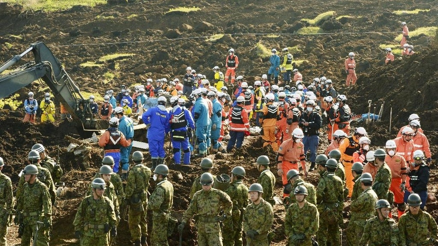 Rescuers search for missing persons at the site of a landslide in Minamiaso, Kumamoto prefecture, Japan Wednesday, April 20, 2016. Searchers continue digging in southern Japan where twin earthquakes triggered landslides. (Hiroko Harima/Kyodo News via AP) JAPAN OUT, MANDATORY CREDIT