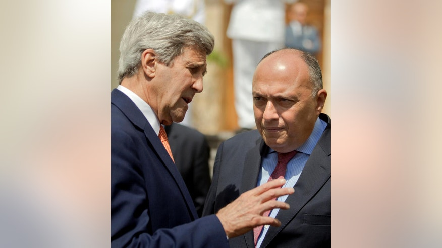 U.S. Secretary of State John Kerry, left, talks to Egyptian Foreign Minister Sameh Shoukry, as he leaves following his meeting with Egyptian President Abdel-Fattah el-Sissi, at the Presidential palace in Cairo, Egypt, Wednesday, April 20, 2016. (AP Photo/Amr Nabil, Pool)