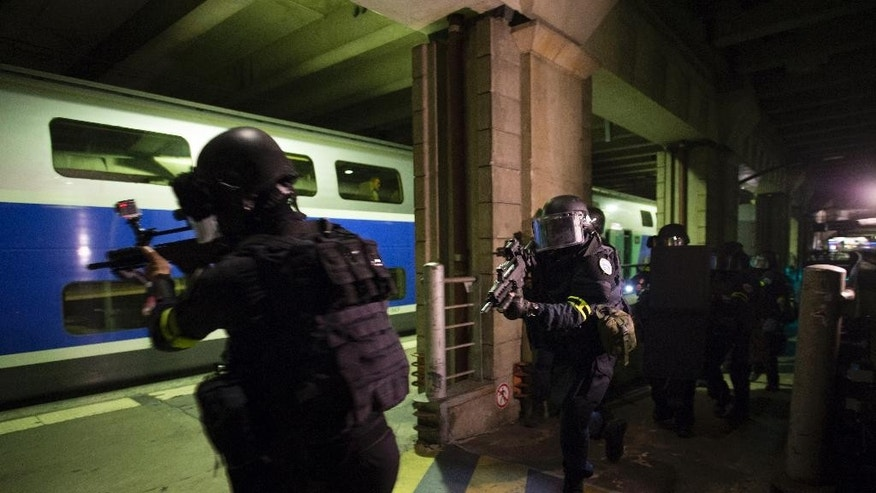 Members of the National Gendarmerie Intervention Group (GIGN) take postion during a terror attack exercise at the Gare Montparnasse railway station in Paris, Wednesday, April 20, 2016.  France is reorganizing its police special forces, responding to allegations that rivalries between the three major branches of law enforcement hampered the response to the attacks in November. (Miguel Medina, Pool Photo via AP)