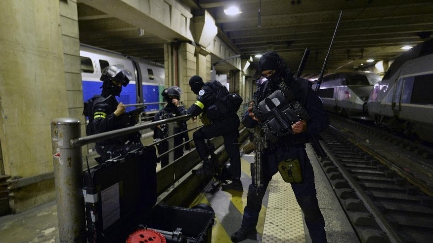A member of the Research and Intervention Brigades(BRI) checks a robot during a terror attack exercise at the Gare Montparnasse railway station in Paris, Wednesday, April 20, 2016.  France is reorganizing its police special forces, responding to allegations that rivalries between the three major branches of law enforcement hampered the response to the attacks in November. (Miguel Medina, Pool Photo via AP)