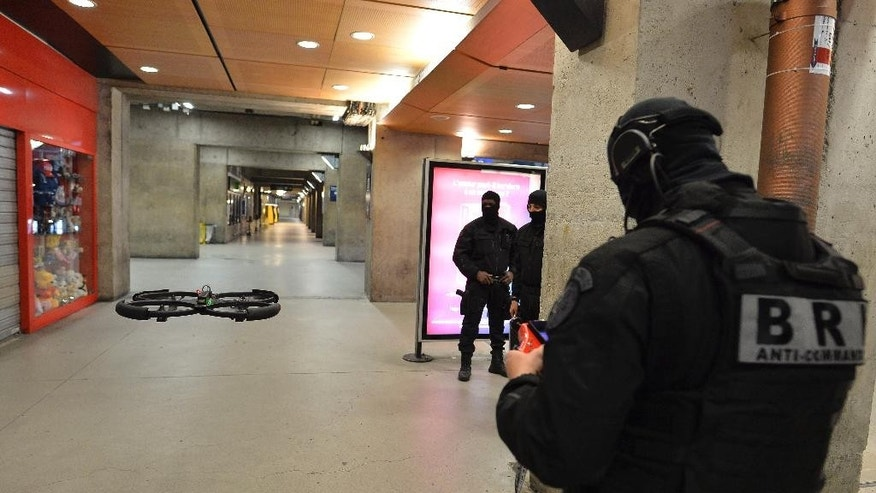A member of the Research and Intervention Brigades (BRI)  controls a drone during a terror attack exercise at the Gare Montparnasse railway station in Paris, Wednesday, April 20, 2016.  France is reorganizing its police special forces, responding to allegations that rivalries between the three major branches of law enforcement hampered the response to the attacks in November. (Miguel Medina, Pool Photo via AP)