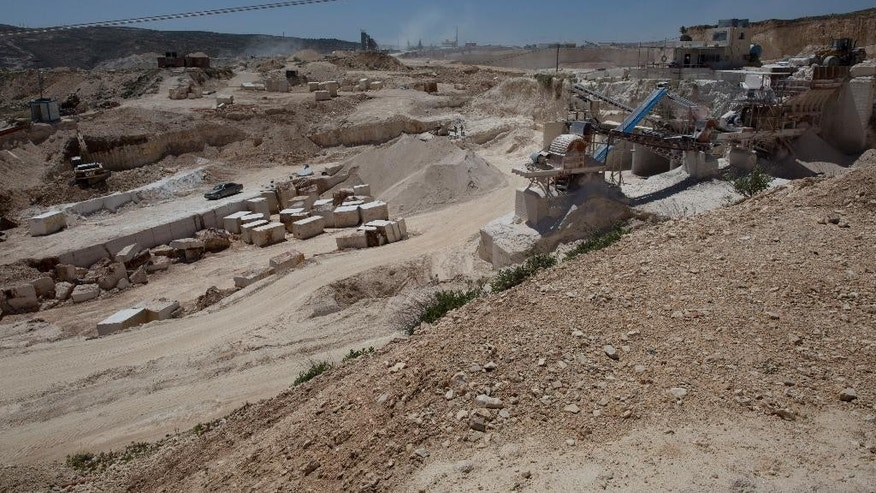 In this Tuesday, April 19, 2016 photo, a Palestinian quarry is seen in the West Bank village of Beit Fajar, Bethlehem. The economic future of the Palestinian town of Beit Fajar looks bleak after Israel's military shut some three dozen quarries and put 3,500 jobs at risk, paralyzing the dominant local industry. (AP Photo/Nasser Nasser)