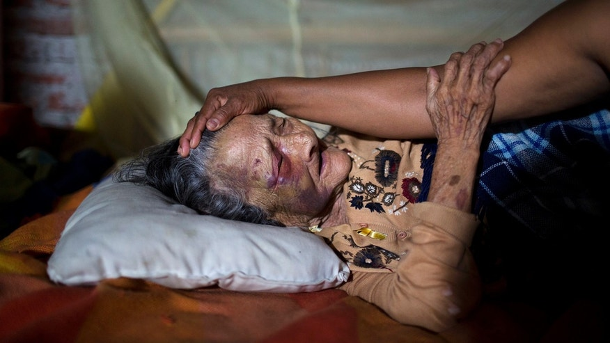 April 19, 2016: Maria Victoria, 89, is comforted by her daughter Mariana in Estancia Las Palmas, Ecuador. Maria Victoria was injured when a column fell on her after 7.8-magnitude earthquake collapsed her home.